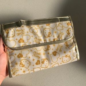 gold hello kitty cosmetics pouch